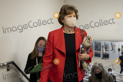 Jeanne Shaheen Photo - UNITED STATES - February 9 Sen Jeanne Shaheen D-NH walks through the Senate subway on the first day of former President Donald Trumps second impeachment trial at the US Capitol in Washington on Tuesday Feb 9 2021 Trump is charged with incitement of insurrection after his supporters stormed the Capitol in an attempt to overturn Novembers election result Credit Caroline Brehman  Pool via CNPAdMedia