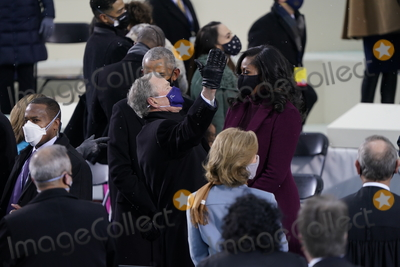 First Lady Michelle Obama Photo - Former United States President George W Bush greets former first lady Michelle Obama prior to Joe Biden taking the Oath of Office as the 46th President of the US at the US Capitol in Washington DC on Wednesday January 20 2021  Credit Chris Kleponis  CNPAdMedia