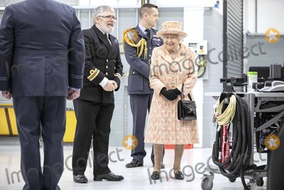 Train Photo - 03022020 - Queen Elizabeth II watches air crew at work on a training model F-35B Lightning II fighter at RAF Marham where she inspected the new integrated training centre that trains personnel on the maintenance of the new RAF F-35B Lightning II strike aircraft Marham Norfolk Photo Credit ALPRAdMedia