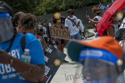 Martin Luther King Photo - People brave the extreme Summer heat to gather at the  Martin Luther King Jr Memorial following the Get Your Knee Off Our Necks March on Washington at the Lincoln Memorial in Washington DC Friday August 28 2020 Credit Rod Lamkey  CNPAdMedia