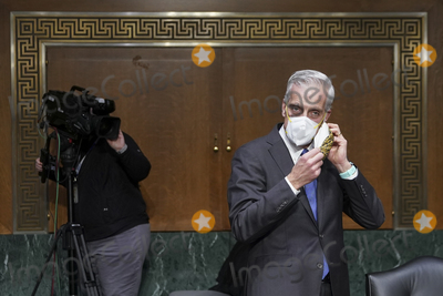 Barack Obama Photo - Denis McDonough US secretary of Veterans Affairs (VA) nominee for US President Joe Biden removes his protective mask during a Senate Veterans Affairs Committee confirmation hearing in Washington DC US on Wednesday Jan 27 2021 As Barack Obamas chief of staff McDonough oversaw the VAs overhaul in response to its 2014 wait-time scandal and previously served as a deputy national security adviser Credit Sarah Silbiger  Pool via CNPAdMedia