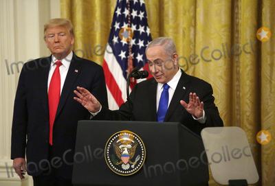 Benjamin Netanyahu Photo - United States President Donald J Trump listens as Israels Prime Minister Benjamin Netanyahu speaks during a meeting in the East Room of the White House in Washington DCon Tuesday January 28 2020 Credit Joshua Lott  CNPAdMedia