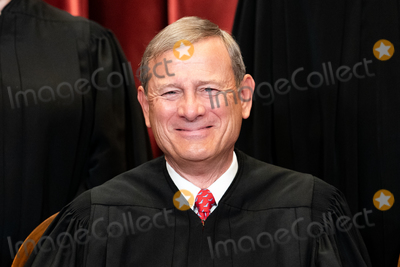 Supreme Court Photo - Chief Justice of the United States John G Roberts Jr sits during a group photo of the Justices at the Supreme Court in Washington DC on April 23 2021  Credit Erin Schaff  Pool via CNPAdMedia