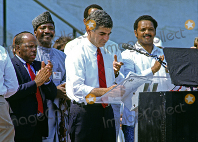 Martin Luther King Jr Photo - Governor Michael Dukakis (Democrat of Massachusetts) the 1988 Democratic Party nominee for President of the United States delivers remarks at the 25th anniversary commemoration of Dr Martin Luther King Jrs March on Washington on the steps of the Lincoln Memorial in Washington DC on August 27 1988  Pictured from left to right Mayor Andrew Young (Democrat of Atlanta Georgia) United States Representative John Lewis (Democrat of Georgia) unidentified Governor Dukakis and the Reverend Jesse JacksonCredit Ron Sachs  CNPAdMedia
