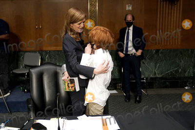 Foreigner Photo - Samantha Power nominee to be Administrator of the United States Agency for International Development embraces her children Ran and Declan Power Sunstein along with her husband Cass Sunstein after her Senate Foreign Relations Committee confirmation hearing on Tuesday March 23 2021Credit Greg Nash  Pool via CNPAdMedia