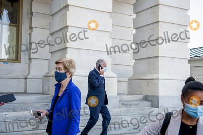 Bob Casey Photo - United States Senator Bob Casey Jr (Democrat of Pennsylvania) right passes by as United States Senator Elizabeth Warren (Democrat of Massachusetts) as she talks with reporters outside the US Capitol following a vote in Washington DC Tuesday September 22 2020 Credit Rod Lamkey  CNPAdMedia