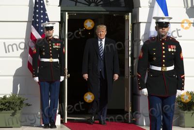 Benjamin Netanyahu Photo - United States President Donald J Trump center awaits the arrival of Benjamin Netanyahu Prime Minister of the State of Israel outside of the White House in Washington DC US on Monday January 27 2020Credit Stefani Reynolds  CNPAdMedia