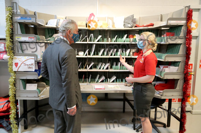 Coronavirus Pandemic Photo - 18th December 2020 - Prince Charles Prince of Wales wearing a mask because of the coronavirus pandemic arrives to visit Royal Mails Delivery Office in Cirencester Gloucestershire Prince Charles visited the Royal Mail in Cirencester to recognise the vital public services that the countrys postal workers provide especially during the coronavirus pandemic and in the run-up to Christmas Photo Credit ALPRAdMedia