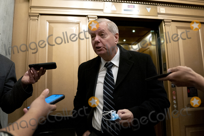 Donald Trump Photo - Senator Lindsey Graham a Republican from South Carolina center speaks to members of the media while arriving to the US Capitol in Washington DC US on Saturday Feb 13 2021 The Senate approved 55-45 a request to consider calling witnesses in the second impeachment trial of Donald Trump a move that may extend the trial that was expected to end within hours Credit Stefani Reynolds - Pool via CNPAdMedia