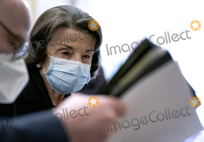 Senator Dianne Feinstein Photo - United States Senator Dianne Feinstein (Democrat of California) right wears a protective mask while walking to the Senate Chamber at the US Capitol in Washington DC US on Tuesday Feb 9 2021 The Senate begins Donald Trumps second impeachment trial today with a fight over whether the proceeding is constitutional as a number of conservative lawyers reject the defense teams claim that a former president cant be convicted of a crime by Congress Credit Stefani Reynolds  Pool via CNPAdMedia