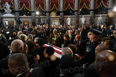 Elijah Cummings Photo - United States Representative John Lewis (Democrat of Georgia) and others visit the casket of US Representative Elijah Cummings (Democrat of Maryland) in National Statuary Hall at the United States Capitol on Thursday October 24 2019 in Washington DC The service preceded Cummings lying in state in front of the US House chambersCredit Matt McClain  Pool via CNPAdMedia