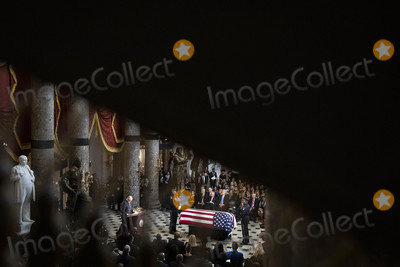 Elijah Cummings Photo - United States House Majority Leader Steny Hoyer (Democrat of Maryland) left speaks near the American flag-draped casket of US Representative Elijah Cummings (Democrat of Maryland) during a memorial service in National Statuary Hall at the US Capitol in Washington DC US on Thursday Oct 24 2019 Cummings a key figure in Democrats impeachment inquiry and a fierce critic of US President Donald J Trump died at the age of 68 on October 17 due to complications concerning long-standing health challenges Credit Al Drago  Pool via CNPAdMedia