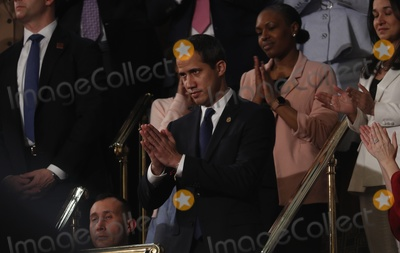 Juanes Photo - Venezuelas opposition leader Juan Guaido gestures as US President Donald Trump delivers his State of the Union address to a joint session of the US Congress in the House Chamber of the US Capitol in Washington US February 4 2020 Credit Leah Millis  Pool via CNPAdMedia