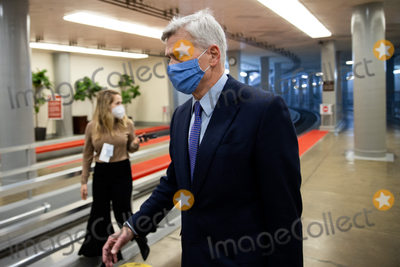 Bill Cassidy Photo - Senator Bill Cassidy R-LA walks on Capitol Hill in Washington Saturday Feb 13 2021 before the fifth day of the second impeachment trial of former President Donald TrumpCredit Graeme Jennings - Pool via CNPAdMedia