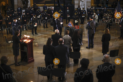 The Ceremonies Photo - A view of the ceremony for late Capitol Police officer Brian Sicknick as he lies in honor in the Rotunda of the US Capitol in Washington US February 3 2021 Credit Carlos Barria  Pool via CNPAdMedia