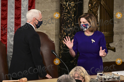 House Speaker Nancy Pelosi Photo - US House Speaker Nancy Pelosi a Democrat from California right and US Vice President Mike Pence wear protective masks while speaking during a joint session of Congress to count the Electoral College votes of the 2020 presidential election in the House Chamber in Washington DC US on Wednesday Jan 6 2021 Congress is meeting to certify Joe Biden as the winner of the 2020 presidential election with scores of Republican lawmakers preparing to challenge the tally in a number of states during what is normally a largely ceremonial event Credit Erin Scott  Pool via CNPAdMedia
