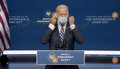 Queen Photo - In this image from the Biden Presidential Transition video feed United States President-elect Joe Biden removes his mask as he prepares to make a statement on the Affordable Care Act at the Queen Theatre in Wilmington Delaware on Tuesday November 10 2020Credit Biden Presidential Transition via CNPAdMedia
