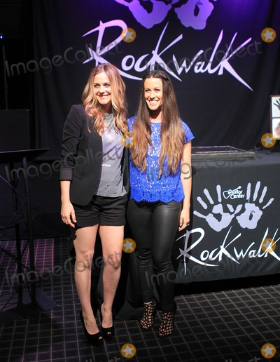 ALANIS MORRISSETTE Photo - 21 August 2012 - Hollywood California - Alicia Silverstone Alanis Morissette Hollywoods RockWalk Induction Ceremony Honoring Alanis Morrissette Held at Guitar Center Photo Credit Kevan BrooksAdMedia