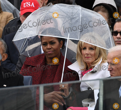 Jill Biden Photo - Michelle Obama and Dr Jill Biden share an umbrella as President Donald Trump delivers his inaugural address at the inauguration on January 20 2017 in Washington DC  Trump became the 45th President of the United States Photo Credit Pat BenicCNPAdMedia