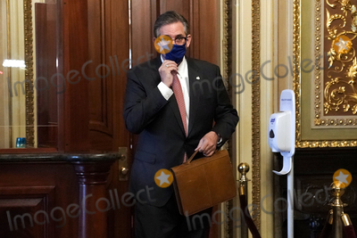 President Trump Photo - Bruce Castor Jr attorney for former President Donald Trump heads to the Senate Chamber before the fifth day of the impeachment trial of former President Trump on Saturday February 13 2021Credit Greg Nash - Pool via CNPAdMedia