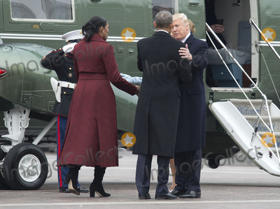 President Obama Photo - President Donald Trump talks to former First Lady Michelle Obama as he escorts her and former President Obama to a helicopter to depart the inauguration on Capitol Hill in Washington DC on January 20 2017 President-Elect Donald Trump was sworn-in as the 45th President Photo Credit Kevin DietschCNPAdMedia