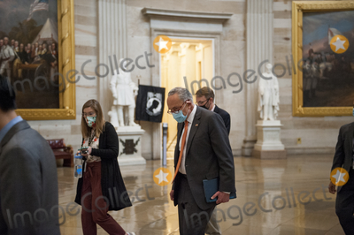 The Used Photo - United States Senate Minority Leader Chuck Schumer (Democrat of New York) makes his way through the US Capitol Rotunda for a meeting with House Speaker Nancy Pelosi D-Calif White House Chief of Staff Mark Meadows and US Treasury Secretary Steven Mnuchin regarding the COVID-19 economic stimulus package at the US Capitol in Washington DC Thursday August 6 2020 Credit Rod Lamkey  CNPAdMedia
