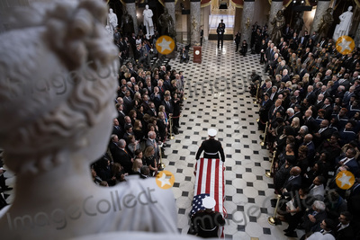 Elijah Cummings Photo - The flag-draped casket of late United States Representative Elijah Cummings (Democrat of Maryland) is carried through National Statuary Hall during a memorial service at the US Capitol in Washington DC US on Thursday Oct 24 2019 Cummings a key figure in Democrats impeachment inquiry and a fierce critic of US President Donald J Trump died at the age of 68 on October 17 due to complications concerning long-standing health challenges Credit Al Drago  Pool via CNPAdMedia