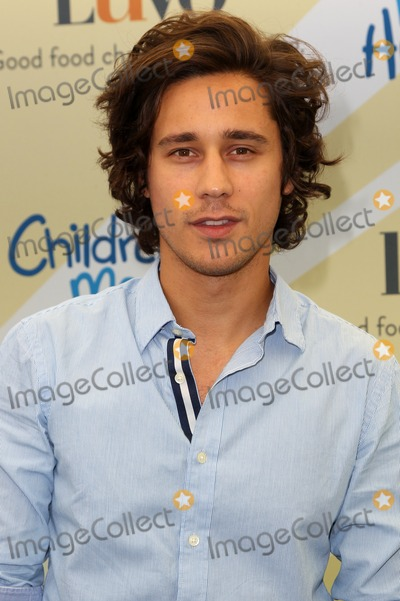 Peter Gadiot Photo - Beverly Hills CA - June 14 Peter Gadiot Attending Children Mending Hearts Empathy Rocks A Spring into Summer Bash At Private Residence California on June 14 2014 Photo Credit Faye Sadou  UPA  Retna Ltd