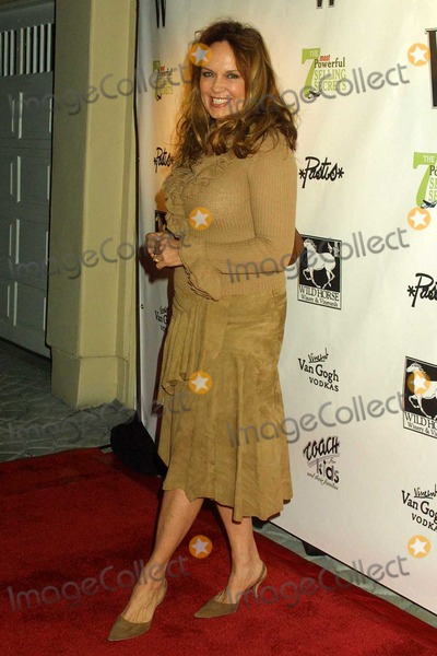 Catherine Bach Photo - Catherine Bach at the W Magazine honors author John Livesay at a private residence in Bel Air CA 01-22-04