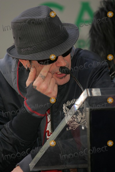 Motley Crue Photo - Tommy Lee of Motley Crueat the ceremony honoring them with the 2301st star on the Hollywood Walk of Fame Hollywood Boulevard CA 01-25-06