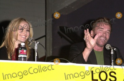 Arnold Schwarzenegger Photo -  Arnold Schwarzenegger and Sarah Wynter at the LA Comic Book Convention to promote the film The 6th Day 11-12-00