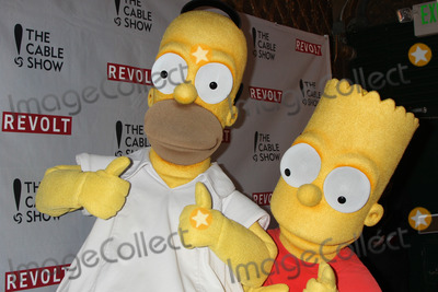 Homer Simpson Photo - Homer Simpson Bart Simpsonat the NCTAs Chairmans Gala Celebration of Cable with REVOLT The Belasco Theater Los Angeles CA 04-30-14