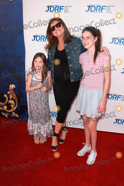 Tiffani-Amber Thiessen Photo - Tiffany Amber Thiessen and friends daughtersat Disneys Cinderella Advance Screening Disney Main Theater Burbank CA 03-08-15