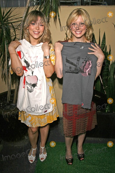 Ashley Peldon Photo - Ashley Peldon and Courtney Peldon holding shirts by Roger Claude Clothing  at the Launch party for Starring Fragrances and Charmed Jewelry benefitting Tree People Whole Foods Lifestyle Store Los Angeles CA 04-21-08
