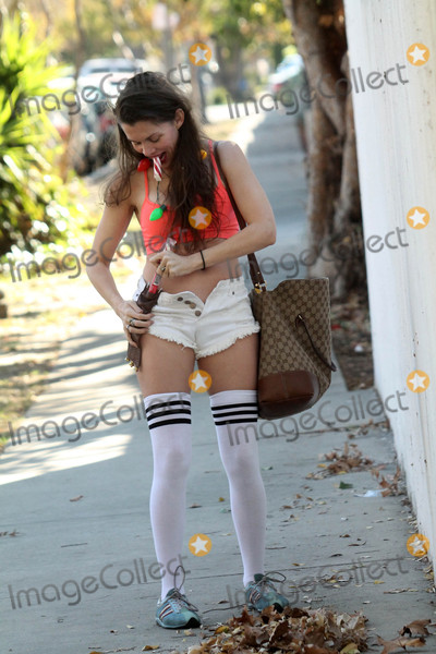 Alicia Arden Photo - Alicia Ardenthe Baywatch actress is spotted Christmas shopping  wearing tiny shorts and thigh-high socks and having a candy cane problem while looking for her phone Los Angeles CA 12-21-17