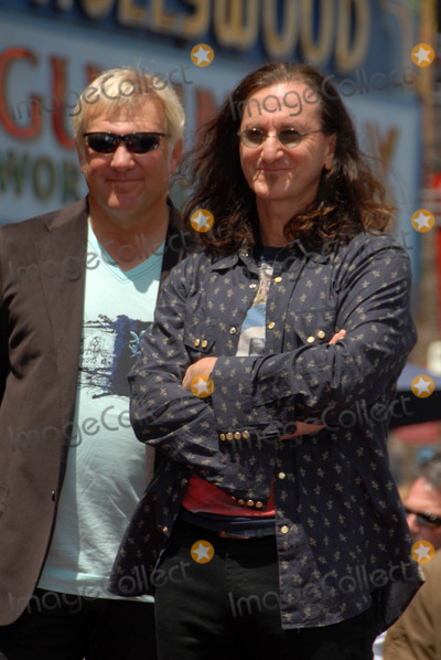 Alex Lifeson Photo - Alex Lifeson and Geddy Leeat the induction ceremony for RUSH into the Hollywood Walk of Fame Hollywood CA 06-25-10