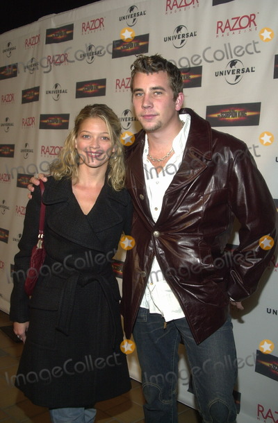 Amanda Detmer Photo - Amanda Detmer and date Ian at the launch party for the DVD release of Universals The Scoprion King at the Virgin Megastore West Hollywood CA 09-30-02
