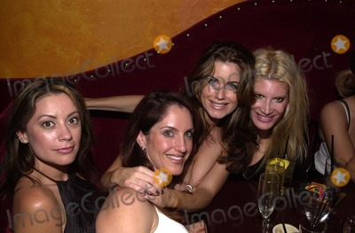 Carrie Stevens Photo - Carrie Stevens and friends at a Tongue Magazine party to celebrate the release of the second KISS condom Studded Paul Barfly West Hollywood CA 09-27-02