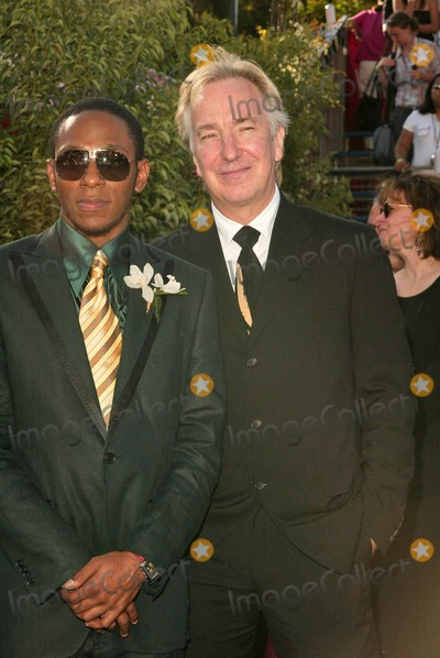 Alan Rickman Photo - Mos Def and Alan Rickman at the 56 Annual Primetime Emmy Awards at The Shrine Auditorium Los Angeles CA 09-19-04