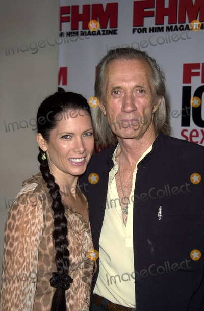 Annie Bierman Photo - Annie Bierman and David Carradine at FHM Magazines Sexiest Party of the Year to celebrate its annual 100 Sexiest Women in the World issue Raleigh Studios Hollywood CA 06-05-03