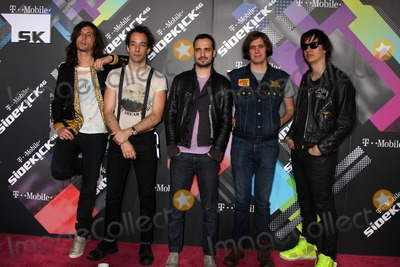 Nikolai Fraiture Photo - LOS ANGELES - APR 20  Musicians Nick Valensi Albert Hammond Jr Fabrizio Moretti Nikolai Fraiture and Julian Casablancas of The Strokes arriving at the Launch Of The New T-Mobile Sidekick 4G  at Old RobinsonMay Building on April 20 2011 in Beverly Hills CA