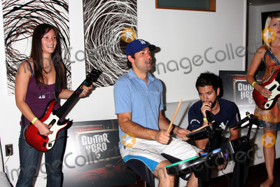 Amy Pham Photo - Amy Pham Zachary Levi Joshua Gomez  Ashley CampbellChuck Kickoff party presented by Guitar Hero FiveRoosevelt Hotel Pool Los Angeles  CAOctober 10  2009
