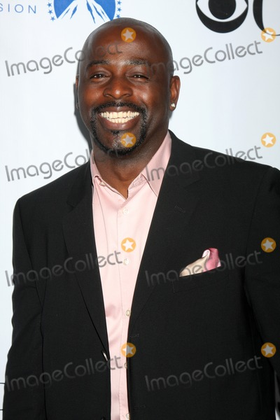Alimi Ballard Photo - Alimi Ballard  arriving at the Numb3rs 100th Episode Party at the Sunset Tower Hotel in West Hollywood  California on April 21 2009