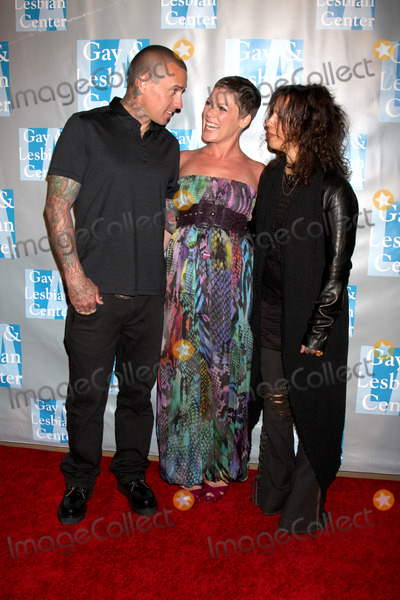 Alecia Moore Photo - Carey Hart  Pink (Alecia Moore) Linda Perryarrives at An Evening with Women - LA Gay  Lesbian Centers GalaBeverly Hilton HotelBeverly Hills CAMay 1 2010