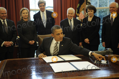 Robert gates Photo - United States President Barack Obama signs the New START Treaty during a ceremony in the Oval Office of the White House with from left US Secretary of Defense Robert Gates US Secretary of State Hillary Rodham Clinton US Senator John Kerry (Democrat of Massachusetts) US Senator Richard Lugar (Republican of Indiana) US Senator Dianne Feinstein (Democrat of California) US Senator Thad Cochran (Republican of Mississippi Photo by Leslie E Kossoff  PoolCNP-PHOTOlinknet