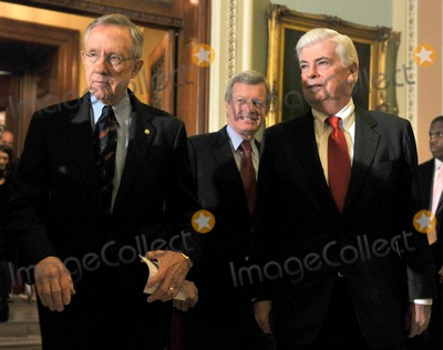 Harry Reid Photo - RESTRICTED NO NEW YORK OR NEW JERSEY NEWSPAPERS WITHIN A 75 MILE RADIUS OF NYCWashington DC - December 24 2009 -- United States Senate Majority Leader Harry Reid (Democrat of Nevada) left US Senator Max Baucus (Democrat of Montana) center and US Senator Christopher Dodd (Democrat of Connecticut) leave the US Senate Chamber to make remarks to the press after voting to pass HR 3590 regarding health care reform in the US Capitol on Thursday December 24 2009  The vote which was along party lines was 60 Democrats in favor and 39 Republicans againstPhoto by Ron Sachs-CNP-PHOTOlinknet