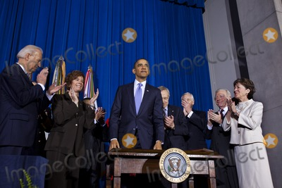 Robert gates Photo - United States President Barack Obama surrounded by lawmakers and bill supporters stands after signing into law the Dont Ask Dont Tell Repeal Act of 2010 which will allow openly gay lesbian or bisexual soldiers to serve in the military in a signing ceremony at the Department of the Interior in Washington DC on Wednesday 22 December 2010 The repeal will take at least 60 days to go into effect and has the backing of most of the military including Defense Secretary Robert GatesPhoto by Jim Lo Scalzo - Pool via CNP-PHOTOlinknet