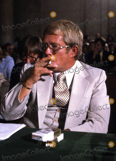 Jimmy Carter Photo - Billy Carter brother of United States President Jimmy Carter smokes a cigarette as he prepares to testify before the US Senate Judiciary Subcommittee hearing To Investigate Activities of Individuals Representing Interests of Foreign Governments also known as Billygate on August 21 1980  The subcommittee was investigating Mr Carters involvement with the Libyan governmentPhoto by Arnie SachsCNP-PHOTOlinknet