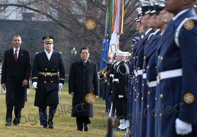Alex Wong Photo - WASHINGTON DC - JANUARY 19  US President Barack Obama (L) and Chinese President Hu Jintao (R) inspect the honor guards as they participate during a state arrival ceremony at the South Lawn of the White House January 19 2011 in Washington DC Hu and President Obama will hold a press conference at the White House later today Photo by  Alex WongPoolCNP-PHOTOlinknet