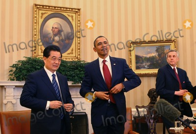 Alex Wong Photo - WASHINGTON DC - JANUARY 19 (AFP OUT) US President Barack Obama (R) and Chinese President Hu Jintao (L) meet in the Oval Office at the White House January 19 2011 in Washington DC Obama and Hu are scheduled to hold a joint press conference and attend a State dinner Photo by  Alex WongPoolCNP-PHOTOlinknet